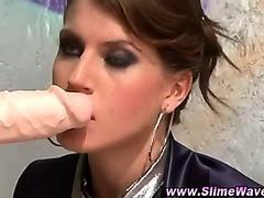 Glamorous gloryhole brunette gives blowjob