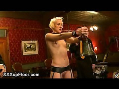 Blonde holding bell and hard flogged bt two men