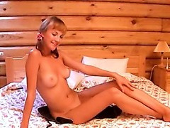 Cute busty coed dancing naked in cottage