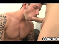 Muscle hunk sucking off a big uncut cock