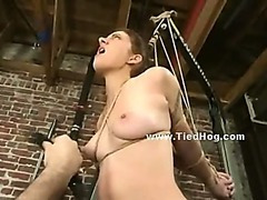 Emo slut with big breasts immobilized in uncanny position and tortured by kinky man in bdsm video
