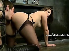 Black amazing mistress in white robe and with huge boobs torturing sex slave in femdom sex video