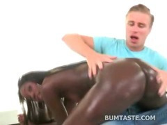 Black beauty spreading her pussy and oiled up to fuck