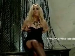 Blonde mistress with curly hair and a sexy ass undresses slowly for her sex slaves
