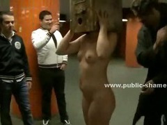 Blonde whore in small dress gets her clothes ripped in public and is humiliated naked outdoor