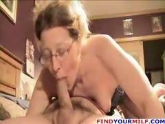 Amateur older wife gives blowjob and footjob