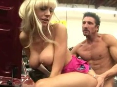 Busty blondie fucked over the car
