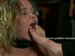 Redhead beautifull lady with big boobs and tied in a club in undressed by public
