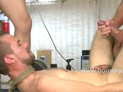 Kyle takes a cock in a hard bondage fuck