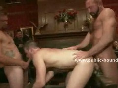 Big strong masculing gay stud in leather pants tortures slave in ropes in front of the public