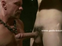 Ropes hold tied gay hunk leaving him powerless in the hands of naked strong master in bondage sex